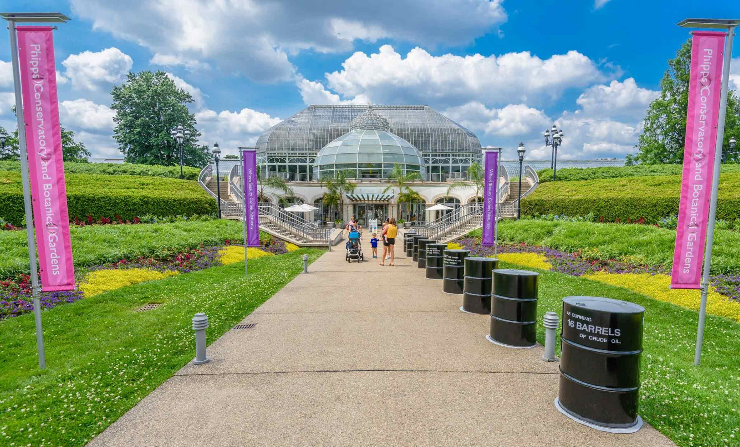 In a new display at Phipps' entrance, 16 oil barrels in a line show visitors the amount of CO2 they can prevent from being released into the atmosphere by switching to renewable energy.